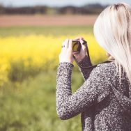 Girl Taking a Photo in Nature
